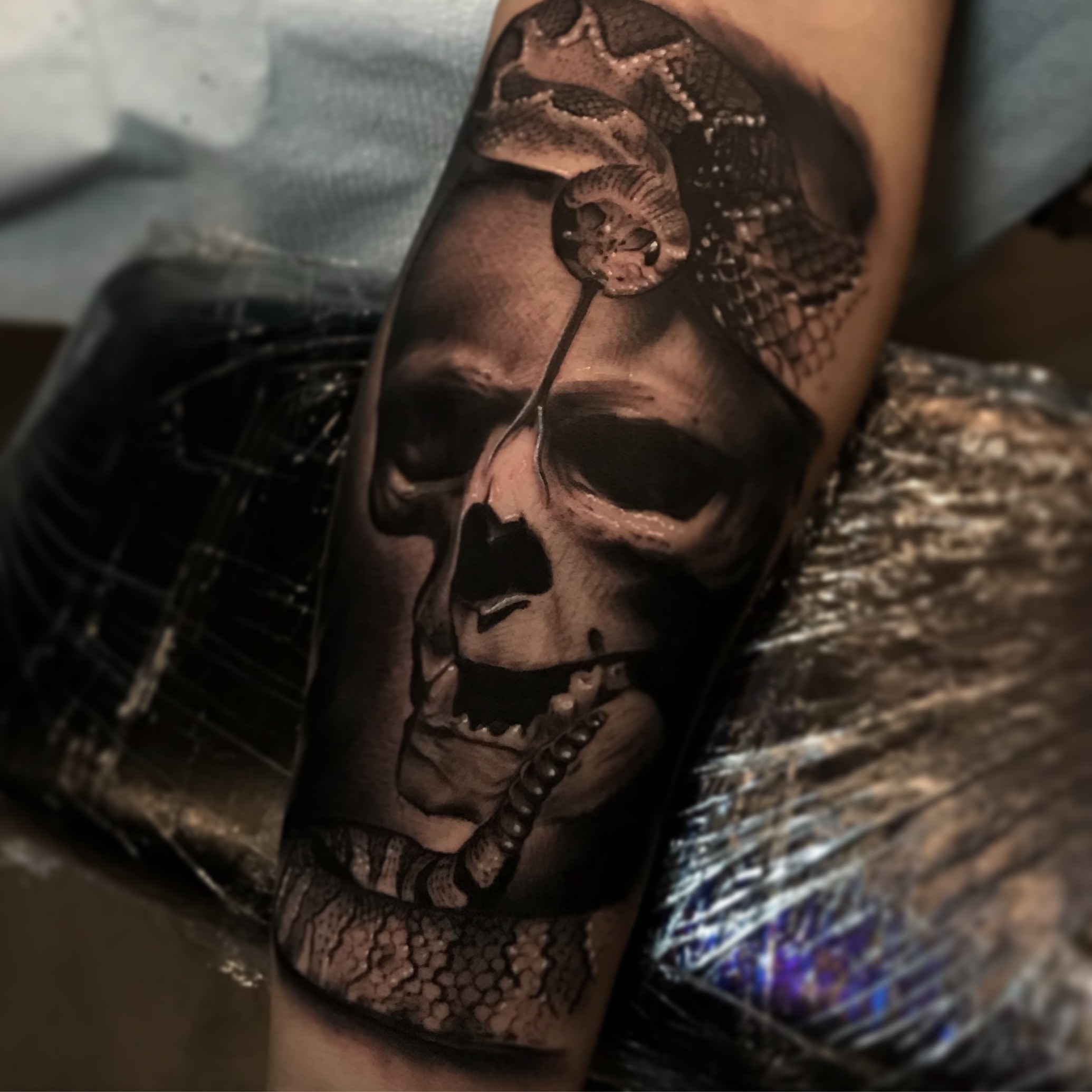 mike flores faces in the dark tattoo shop by tye harris